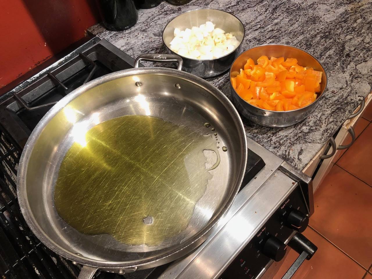 Olive oil heating in a pan | AnnaMaria's