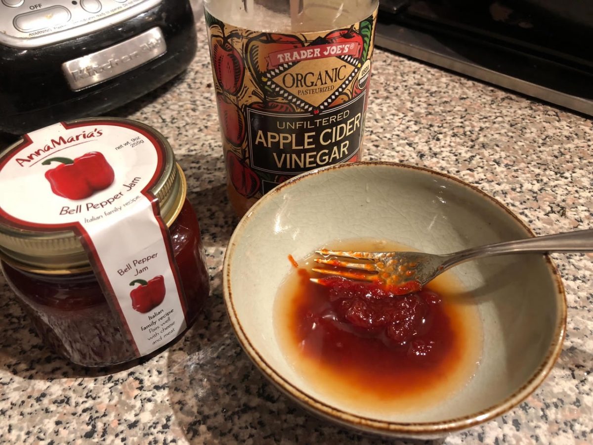 Bell pepper jam and cider vinegar dressing in a mixing bowl | AnnaMaria's