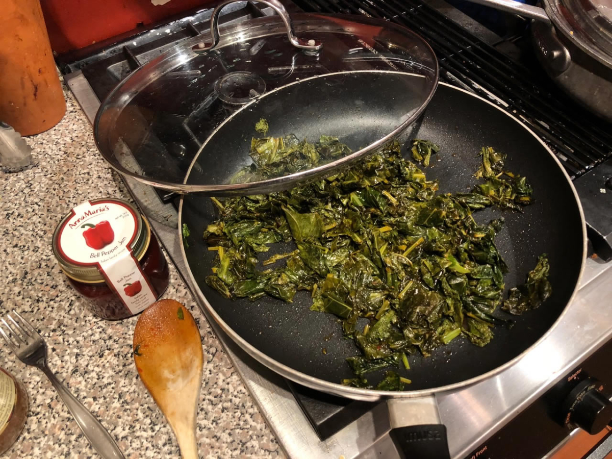 Sauteed collard greens in a pan | AnnaMaria's