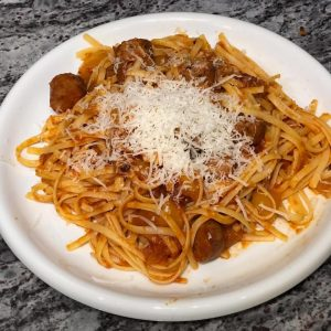 Plated pasta with chicken sausage with tomato Pinerolo sauce | AnnaMaria's