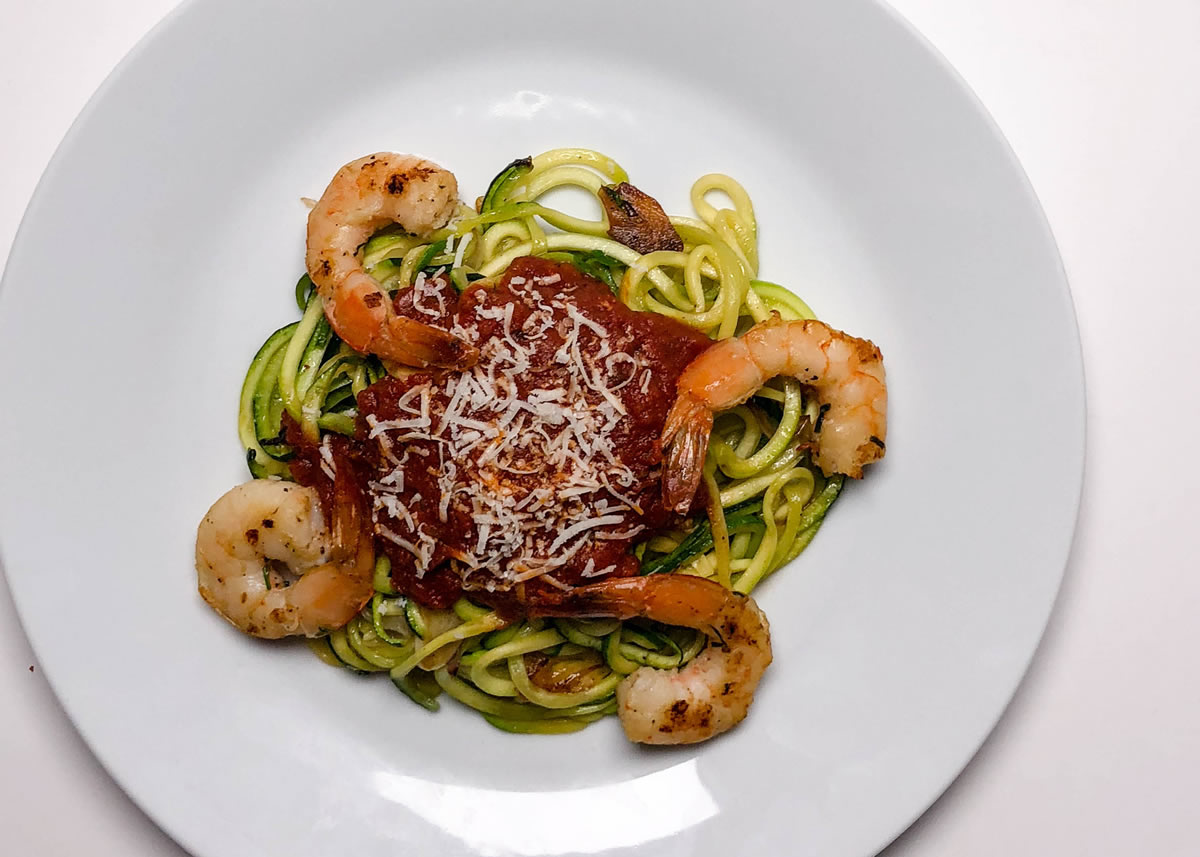 Plated keto shrimp with pasta sauce over zucchini noodles | AnnaMaria'si