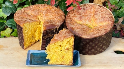 Einkorn Panettone on display with flowers | Anna Maria's Foods