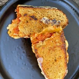 Einkorn wheat bread grilled sandwich on a plate | Anna Maria's Foods