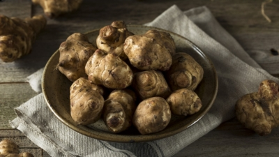 Sunchokes known as Jerusalem Artichokes or Topinambur in Italy on a plate | AnnaMaria's