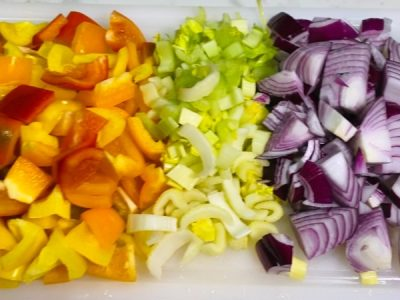 Colorful cut up vegetables for caponata | AnnaMaria's